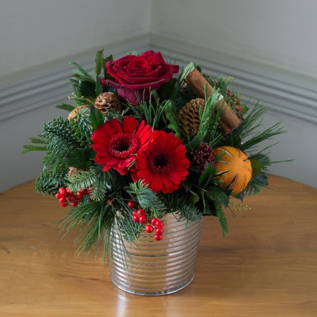 Festive Posy An Array Of Red Flowers, Berries, Cinnamon Sticks & Pine Cones in Vintage Bucket