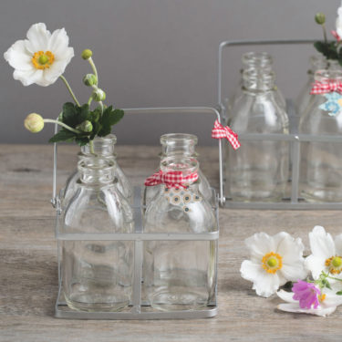 set of 4 little milk bottles in metal crate