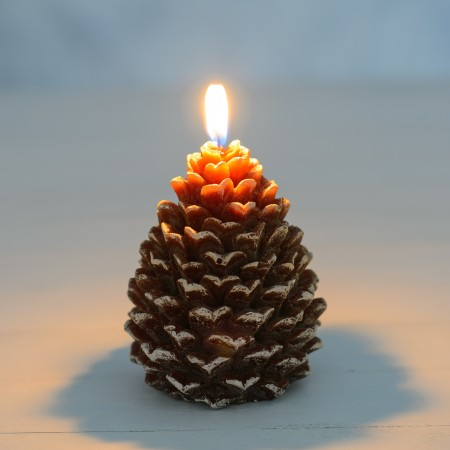 Lit Snowy Pine Cone Candle