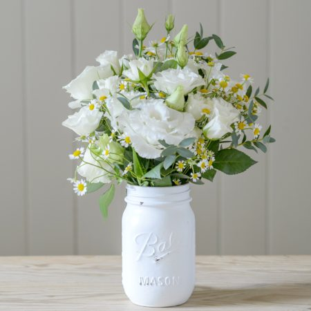 VINTAGE MASON JAR OF WHITE SPRING FLOWERS