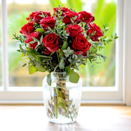 12 red roses & fragrant foliage