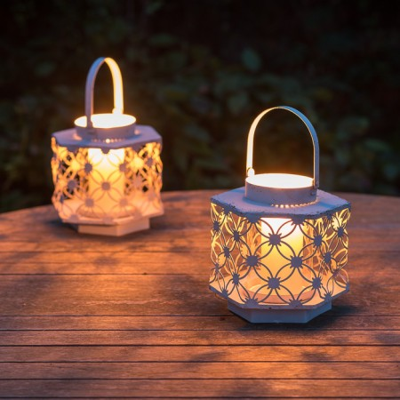 Lattice metal and glass garden lantern with candle