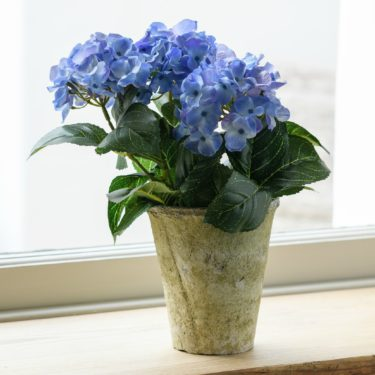 FAUX BLUE HYDRANGEA PLANT IN RUSTIC MOSS POT