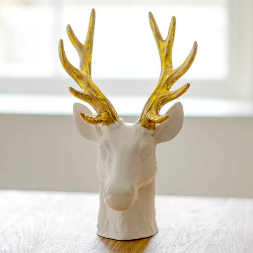 WHITE PORCELAIN STAG HEAD WITH GOLDEN ANTLERS