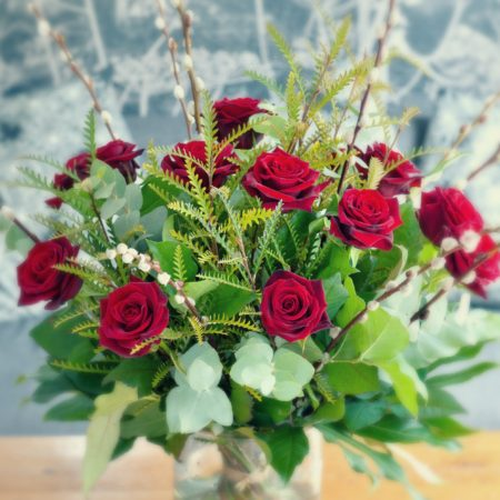 GLORIOUS-VALENTINE-RED-ROSE-IN-A-MASS-OF-GARDEN-FOLIAGE-450x450