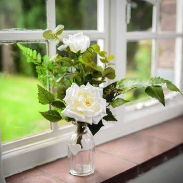 faux rose garden posy on shelf