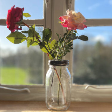 florist arranging vintage glass jar