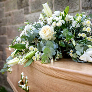 white lily and rose casket tribute