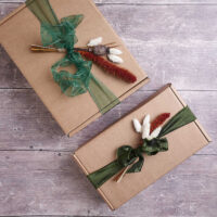 large gift wrapping boxes with dried flowers